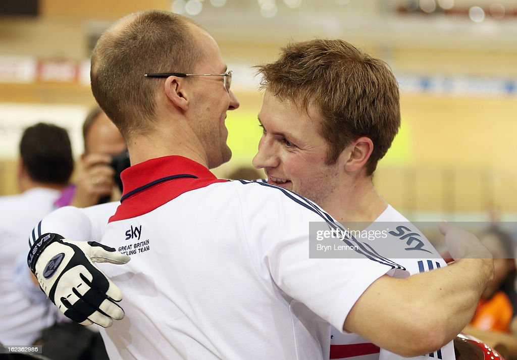 Jason Kenny of Great Britain celebrates with Sprint coach Iain Dyer after winning the Men's Keirin Final on day three of the 2013 UCI Track World Championships at the Minsk Arena on February 22, 2013 in Minsk, Belarus.
