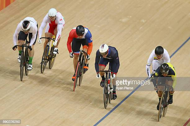 Jason Kenny of Great Britain Matthijs Buchli of the Netherlands and Azizulhasni Awang of Malaysia compete during the Men's Keirin Finals race on Day...