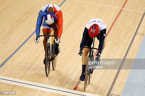 Jason Kenny of Great Britain wins the second heat against Gregory Bauge of France during the Men's Sprint Track Cycling Final and wins gold on Day 10...
