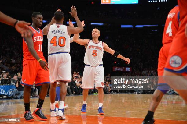 Jason Kidd and Kurt Thomas of the New York Knicks give eachother a high five vs the Philadelphia 76ers on November 4 2012 at Madison Square Garden in...