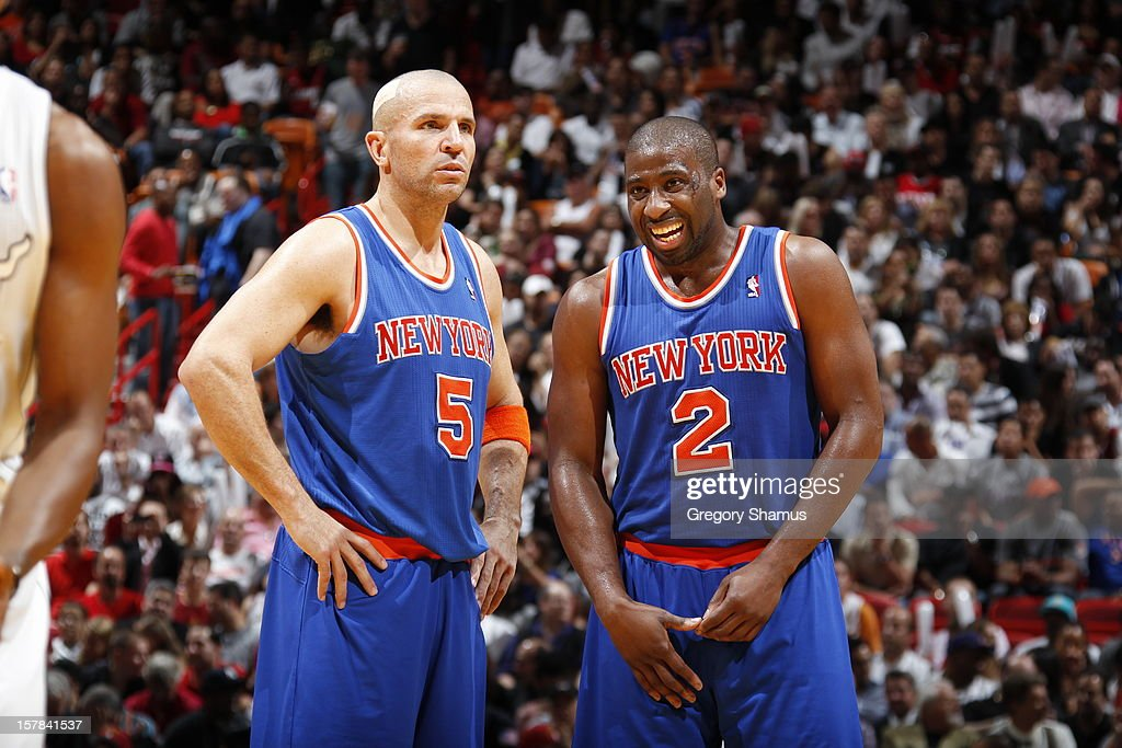 Jason Kidd #5 and Raymond Felton #2 of the New York Knicks catch a break in action to smile during a game on December 6, 2012 at American Airlines Arena in Miami, Florida.