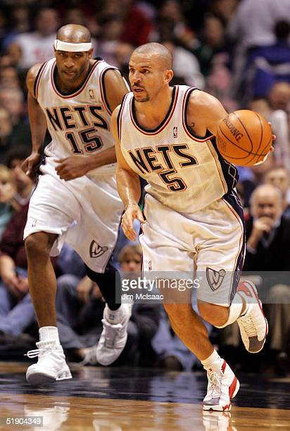 Jason Kidd and Vince Carter of the New Jersey Nets head up court during their game against the Indiana Pacers on December 30 2004 at Continental...