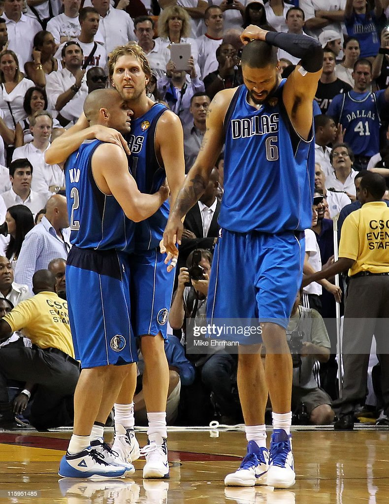 Jason Kidd #2, Dirk Nowitzki #41 and Tyson Chandler #6 of the Dallas Mavericks react on court late in the fourth quarter against the Miami Heat in Game Six of the 2011 NBA Finals at American Airlines Arena on June 12, 2011 in Miami, Florida.