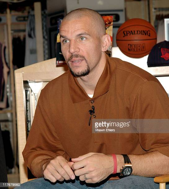 Jason Kidd during Jason Kidd Shaves Lucky Fan's Head to Help Raise Money for Childhood Cancer Research at NBA Store in New York City New York United...