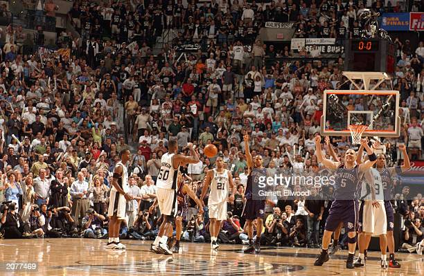 Jason Kidd, Kenyon Martin of the New Jersey Nets and the crowd celebrate as they win Game two of the 2003 NBA Finals against the San Antonio Spurs at...