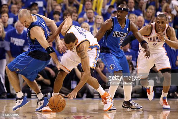 Jason Kidd of the Dallas Mavericks and Thabo Sefolosha of the Oklahoma City Thunder go after a loose ball in the third quarter in Game Three of the...