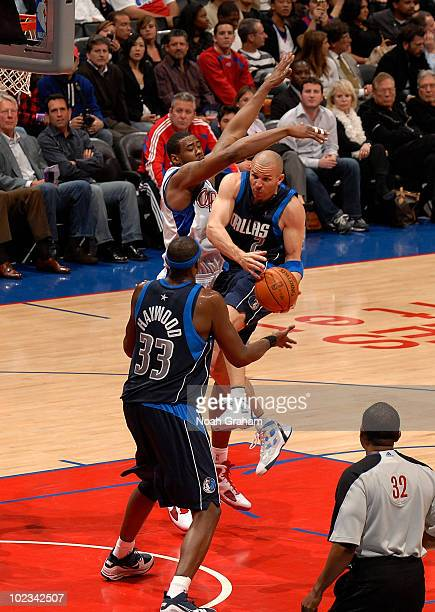 Jason Kidd of the Dallas Mavericks drives the ball to teammate Brendan Haywood during the game against the Los Angeles Clippers at Staples Center on...