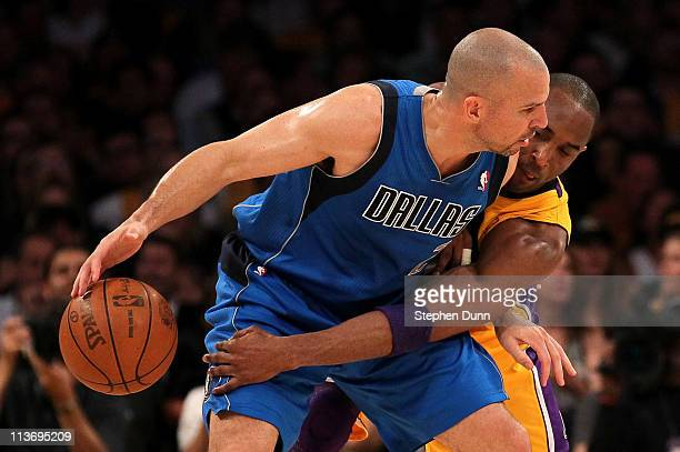 Jason Kidd of the Dallas Mavericks moves the ball as Kobe Bryant of the Los Angeles Lakers goes for the steal in the first quarter in Game Two of the...