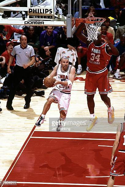 Jason Kidd of the Eastern Conference AllStars drives to the basket past Shaquille O'Neal#34 of the Western Conference during the 52nd NBA AllStar...