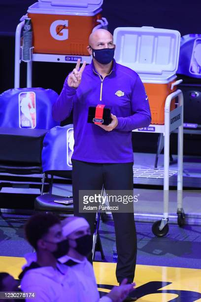 Jason Kidd of the Los Angeles Lakers reacts as he gets his 2019-20 NBA Championship ring during the ring ceremony before the game against the LA...