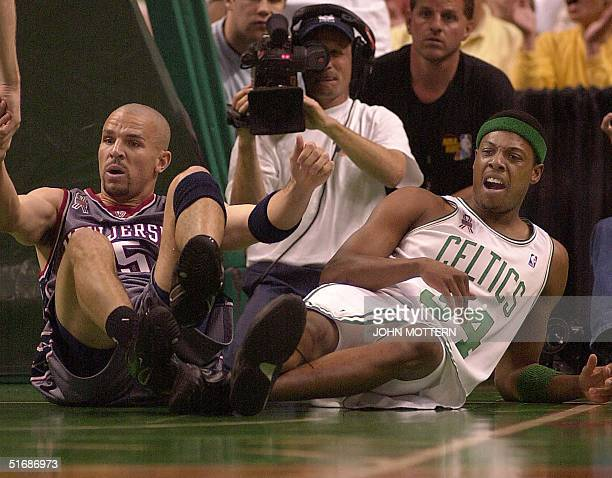 Jason Kidd of the New Jersey Nets and Paul Pierce of the Boston Celtics get up after falling on the floor during game 4 of the NBA Eastern Conference...