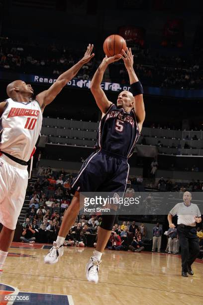 Jason Kidd of the New Jersey Nets attempts a jump shot over Kevin Bogans of the Charlotte Bobcats on December 7 2005 at the Charlotte Bobcats Arena...