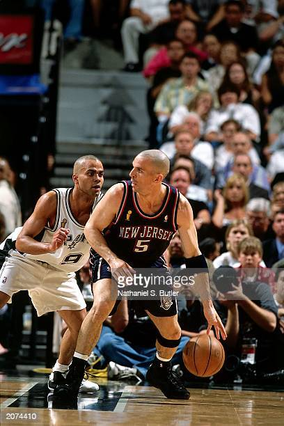 Jason Kidd of the New Jersey Nets backs down Tony Parker of the San Antonio Spurs during Game one of the NBA Finals at the SBC Center on June 4, 2003...