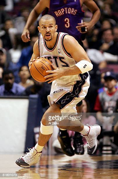 Jason Kidd of the New Jersey Nets brings the ball up court against the Toronto Raptors on December 6 2004 at the Continental Airlines Arena in East...