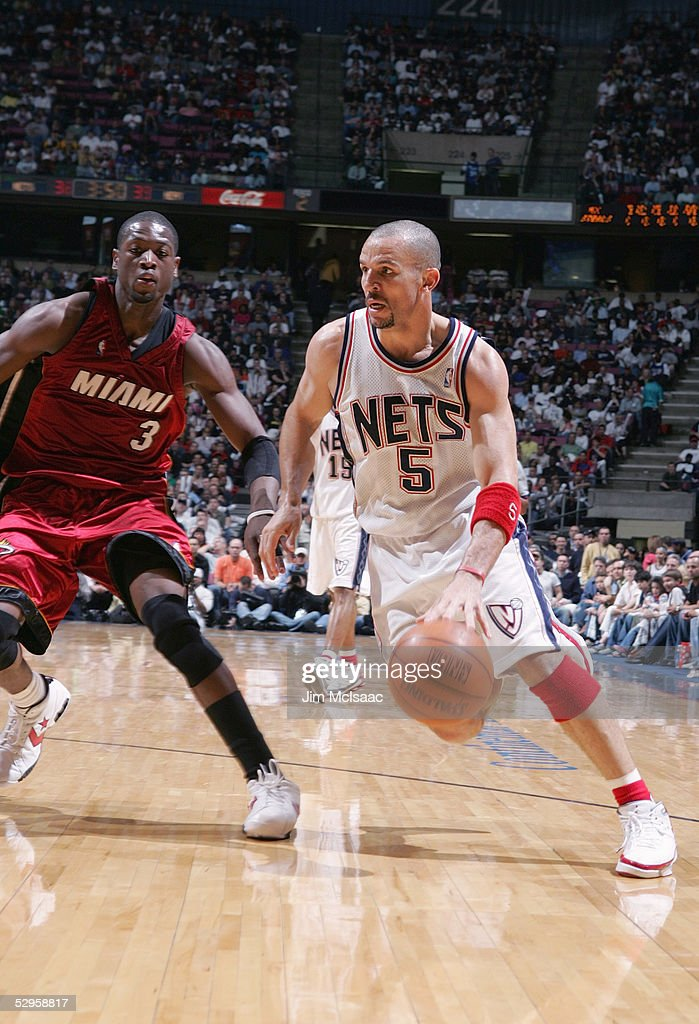 Jason Kidd #5 of the New Jersey Nets dribbles against Dwyane Wade #3 of the Miami Heat in Game four of the Eastern Conference Quarterfinals during the 2005 NBA Playoffs on May 1, 2005 at the Continental Airlines Arena in East Rutherford, New Jersey. The Heat won 110-97 to sweep the series 4-0.