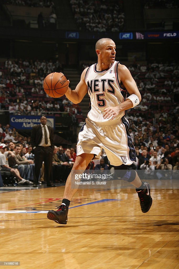 a88e98a92ca Jason Kidd of the New Jersey Nets dribbles down the court against ...