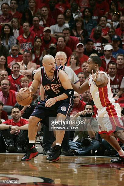 Jason Kidd of the New Jersey Nets drives against Damon Jones of the Miami Heat in Game one of the Eastern Conference Quarterfinals during the 2005...