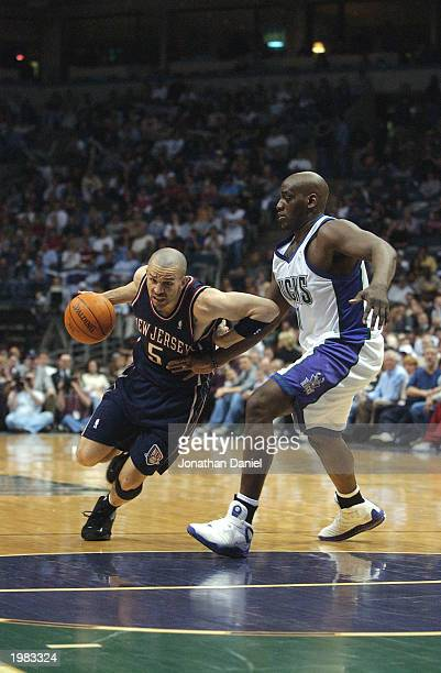 Jason Kidd of the New Jersey Nets drives around Anthony Mason of the Milwaukee Bucks in Game six of the Eastern Conference Quarterfinals during the...