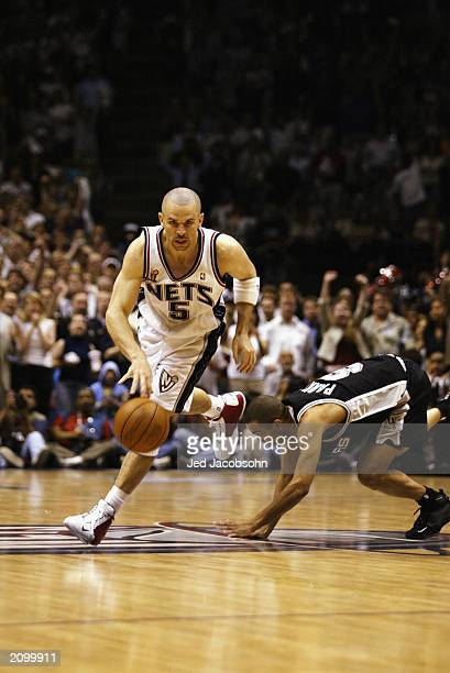 Jason Kidd of the New Jersey Nets drives past Tony Parker of the San  Antonio Spurs 93f36df83