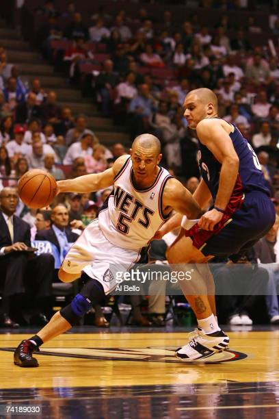 Jason Kidd of the New Jersey Nets drives the ball against Sasha Pavlovic of the Cleveland Cavaliers during Game Six of the Eastern Conference...