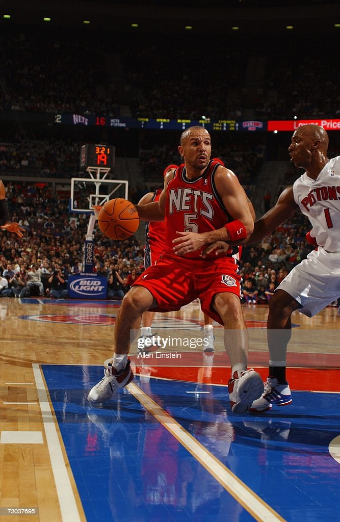 Jason Kidd #5 of the New Jersey Nets drives to the basket against Chauncey Billups #1 of the Detroit Pistons during a game at the Palace of Auburn Hills on December 26, 2006 in Auburn Hills, Michigan. The Pistons defeated the Nets 92-91.
