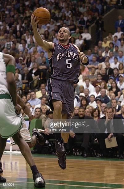 Jason Kidd of the New Jersey Nets drives to the basket during Game 6 of the Eastern Conference Finals at the Fleet Center in Boston Massachusetts on...