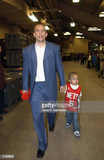 Jason Kidd of the New Jersey Nets enters the arena with son TJ Kidd before Game five of the 2003 NBA Finals against the San Antonio Spurs at...