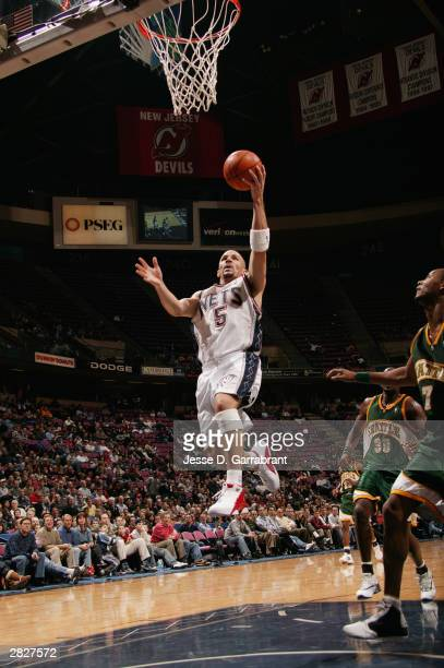 Jason Kidd of the New Jersey Nets goes up for an open layup during the game against the Seattle Sonics at Continental Airlines Arena on December 9...
