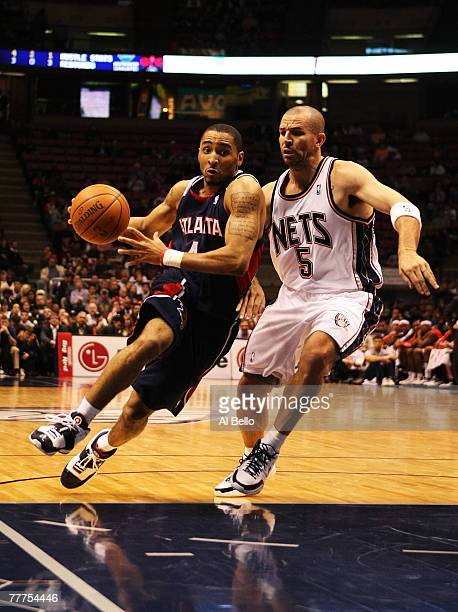 Jason Kidd of the New Jersey Nets guards Acie Law of the Atlanta Hawks during their game on November 6 2007 at the Izod Arena in East Rutherford New...