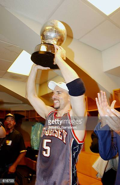 Jason Kidd of the New Jersey Nets holds up the Eastern Conference Championship Trophy after his team defeated the Boston Celtics on May 31 2002 to...