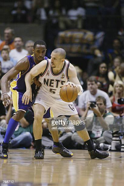 Jason Kidd of the New Jersey Nets is defended by Kobe Bryant of the Los Angeles Lakers in Game four of the 2002 NBA Finals on June 12, 2002 at...