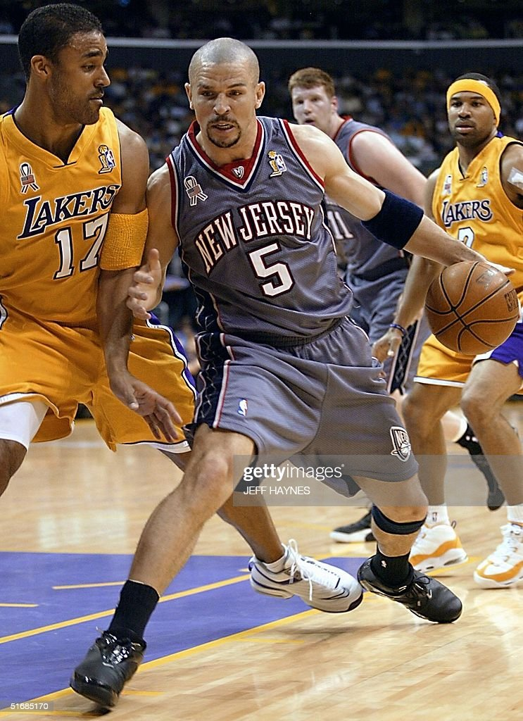 479737eb4e4 Jason Kidd of the New Jersey Nets is guarded by Rick Fox of the Los ...