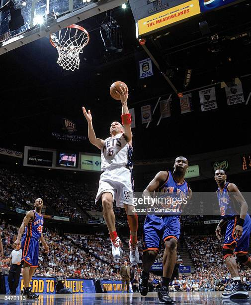 Jason Kidd of the New Jersey Nets lays the ball up in front of Frank Williams of the New York Knicks during Game 1 of the Eastern Conference Playoffs...