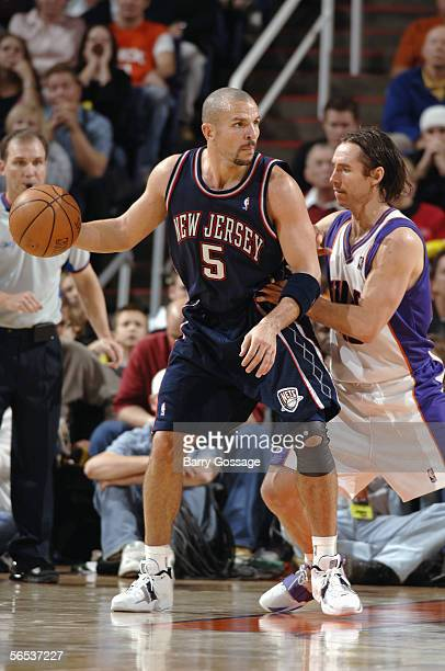 Jason Kidd of the New Jersey Nets moves the ball against Steve Nash of the Phoenix Suns during a game at America West Arena on November 25, 2005 in...
