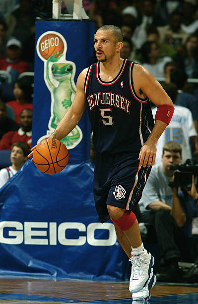 Jason Kidd  5 of the New Jersey Nets moves the ball during the game with 31d40ae7a
