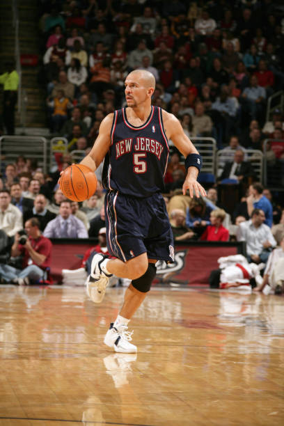 d254a71fb Jason Kidd  5 of the New Jersey Nets moves the ball up court during a