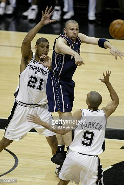 Jason Kidd of the New Jersey Nets passes over Tony Parker of the San Antonio Spurs in game six of the 2003 NBA Finals at the SBC Center on June 15...