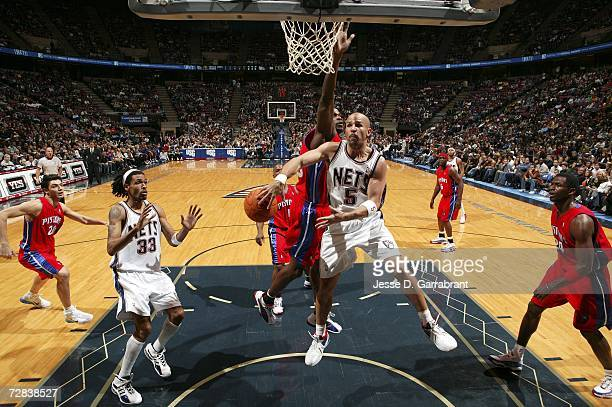 Jason Kidd of the New Jersey Nets passes the ball to teammate Mikki Moore during the game against the Detroit Pistons on December 16, 2006 at the...