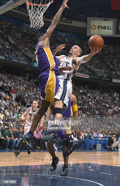 Jason Kidd of the New Jersey Nets puts a shot up against Kobe Bryant of the Los Angeles Lakers during Game four of the 2002 NBA Finals on June 12...