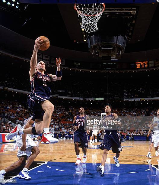 Jason Kidd of the New Jersey Nets shoots a layup against the Orlando Magic during the game at the TD Waterhouse Center on January 29 2004 in Orlando...