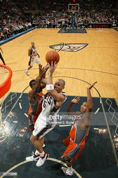 Jason Kidd of the New Jersey Nets shoots in between Amare Stoudemire and Raja Bell of the Phoenix Suns on December 7 2006 at the Continental Airlines...