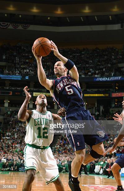 Jason Kidd of the New Jersey Nets shoots over Bimbo Coles of the Boston Celtics in Game four of the Eastern Conference Semifinals during the 2003 NBA...
