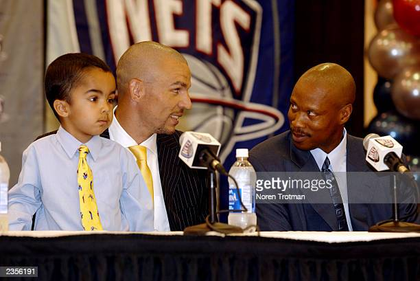 Jason Kidd of the New Jersey Nets smiles alongside son TJ Kidd and Nets head coach Byron Scott during the press press conference and contract...