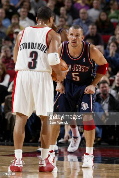 Jason Kidd of the New Jersey Nets squares off with Damon Stoudamire of the Portland Trail Blazers during a game on November 28 2003 at the Rose...
