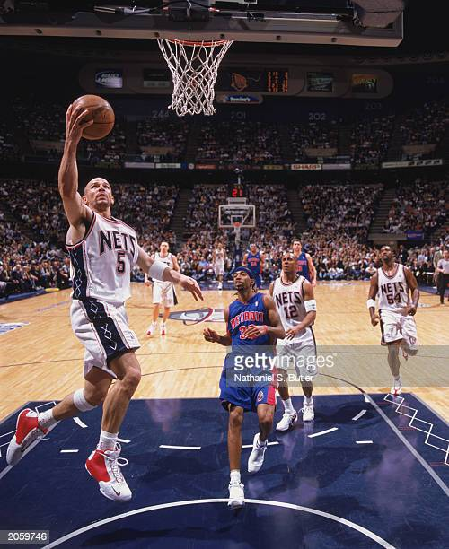 Jason Kidd of the New Jersey Nets takes the ball to the basket in Game Three of the Eastern Conference Finals against the Detroit Pistons during the...