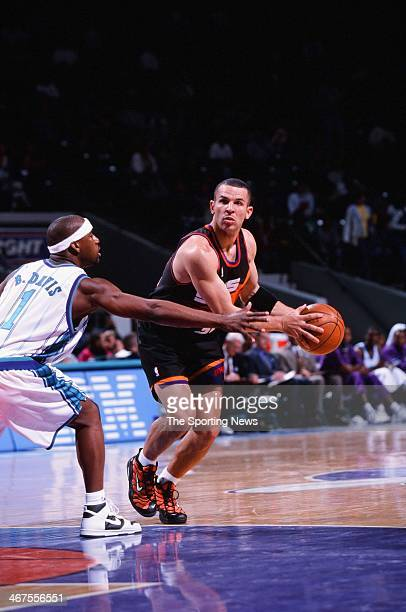 Jason Kidd of the Phoenix Suns moves the ball during the game against the Charlotte Hornets on January 29 2000 at Charlotte Coliseum in Charlotte...