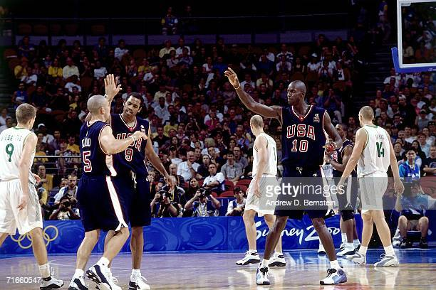 Jason Kidd of the United States National Team receives high fives from his teammates against the Lithuanian National Team during the 2000 Summer...
