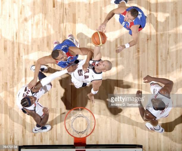 Jason Kidd of the USA Men's Senior National Team rebounds against Richardo Sanchez of Puerto Rico during the semifinals of the 2007 FIBA Americas...