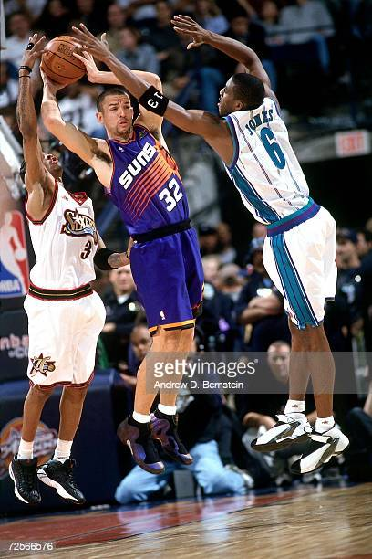 Jason Kidd of the Western Conference AllStars attempts to pass out of a double team against Eddie Jones and Allen Iverson of the Eastern Conference...