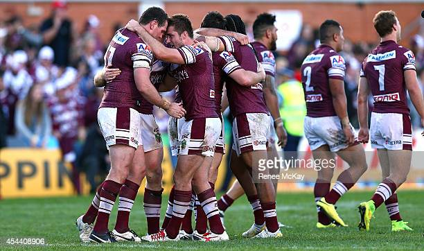 Jason King and Manly team mate Kieran Foran celebrate their teams win at the round 25 NRL match between the Manly Sea Eagles and the Penrith Panthers...